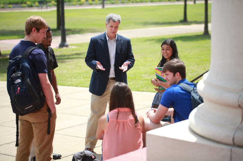 Professor David Thomas meets with students outside