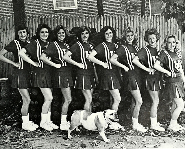 An unofficial live bulldog posing with the cheerleaders in 1980.