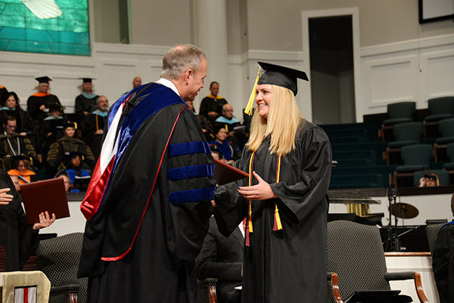 Dr. Dub Oliver gives his very first Union diploma at Summer commencement.