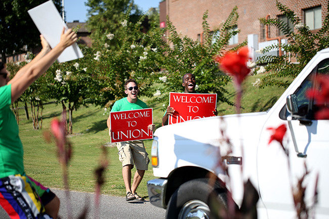 Life Group leaders welcome new students to campus with signs and much excitement