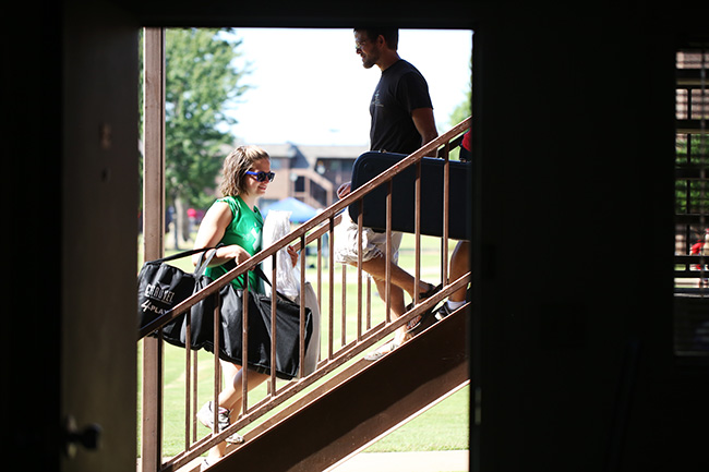 Life group leaders help new students move in