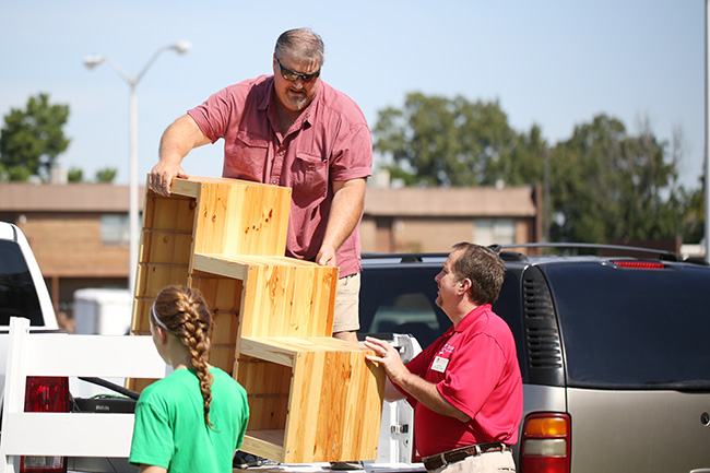 Jim Avery helps a Union parent unload his truck.