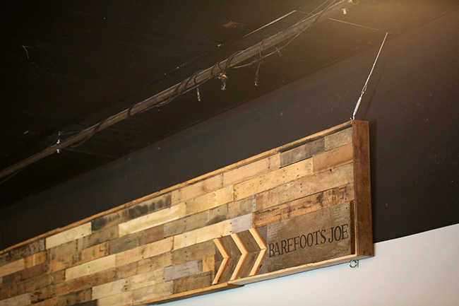 The new wooden sign above the stage in Barefoots Joe