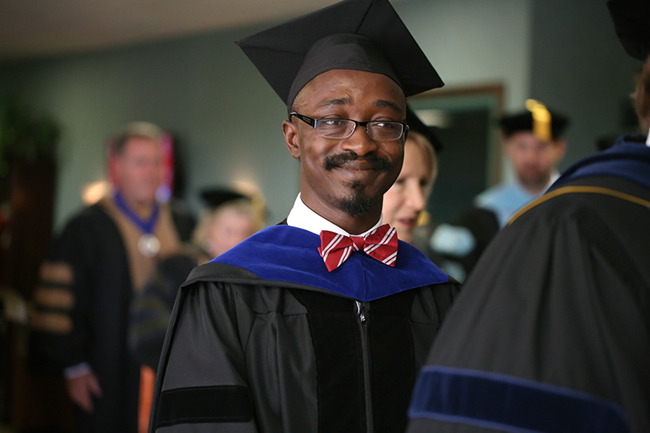 Dr. Richard Addo waiting for the faculty processional.