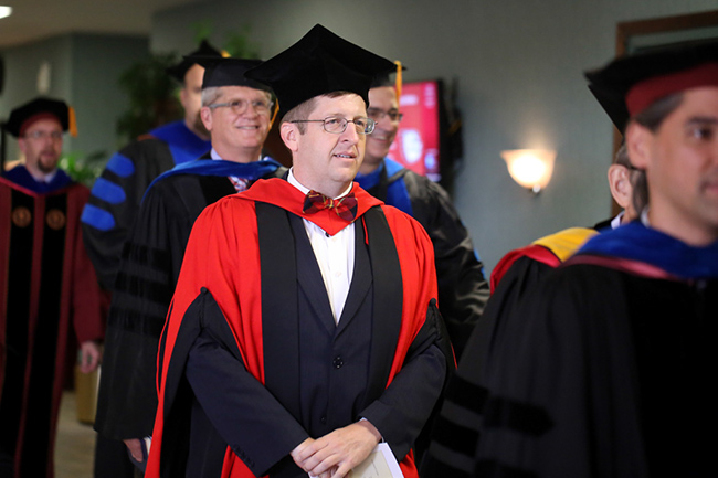 Dr. Van Neste waits for the faculty processional at Convocation