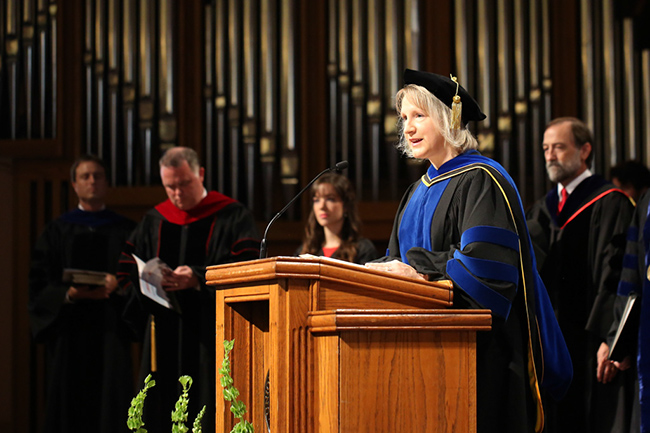 Dr. Jeanette Russ reads scripture.