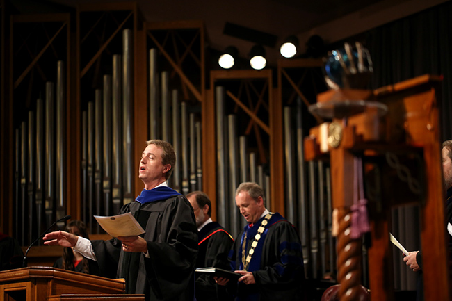 """Dr. Mathews leads the congregation in singing """"How Great Thou Art"""""""