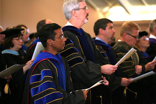 Faculty members sing