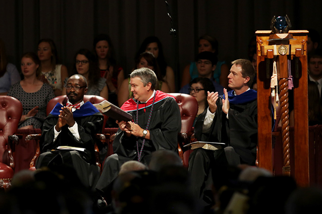 Faculty and Staff members on the stage at convocation.