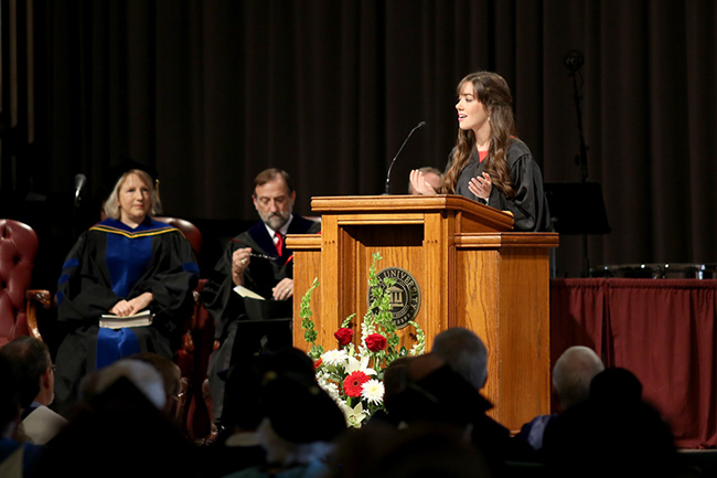Student body president, Jenaye White, addresses students at Convocation