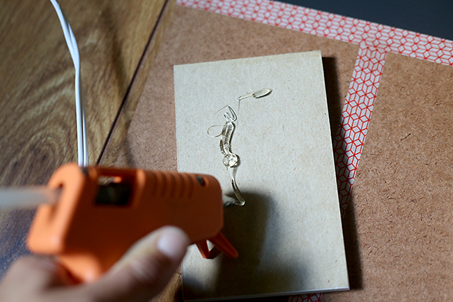 Hot glue notepads to clipboards