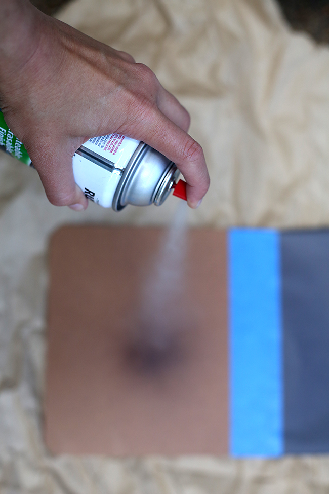 Applying the chalkboard paint using a spray can