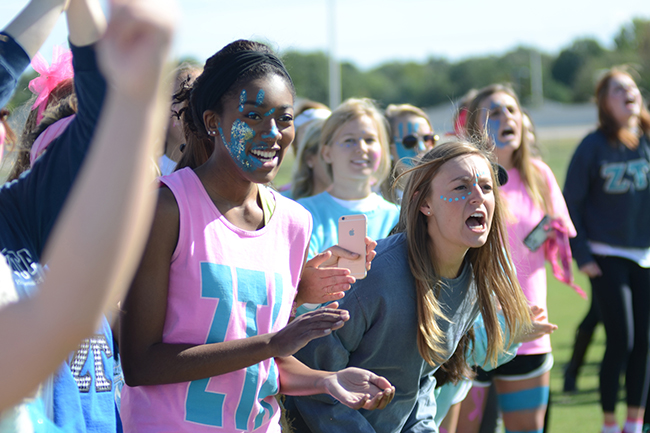 Women of Zeta Tau Alpha cheer for their sisters during Greek Olympics.