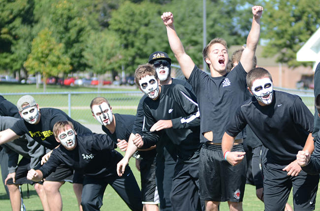 Men of SAE yell and cheer for their fraternity brothers during Greek Olympics.