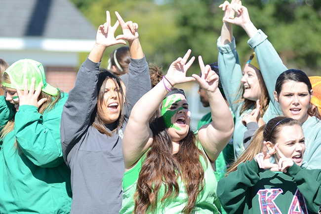 Women of Kappa Delta throw up their KD sign during Greek Olympics