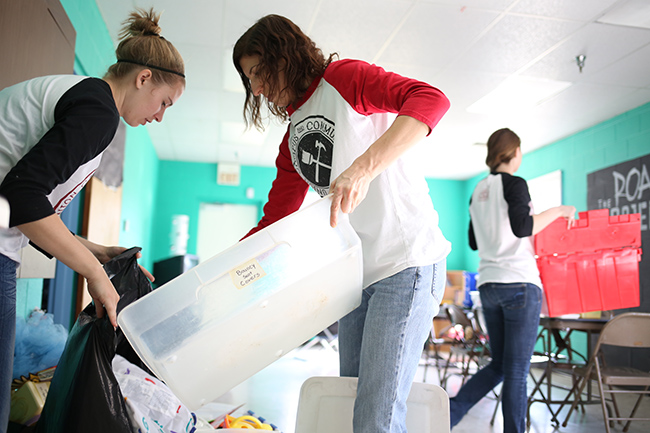 Students and staff work together on a service project