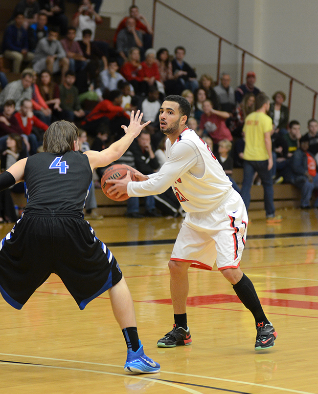 Senior guard, Pedro Faller, looks for a pass in the homecoming game