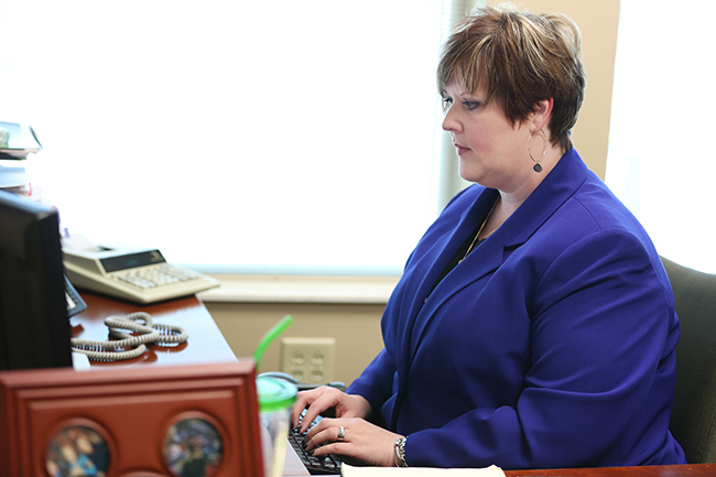 Mandy works at her desk at the Chamber