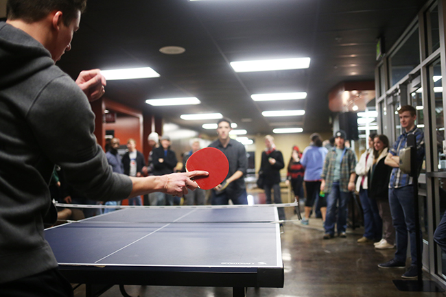 Students participate in a ping pong tournament in the Bowld Commons