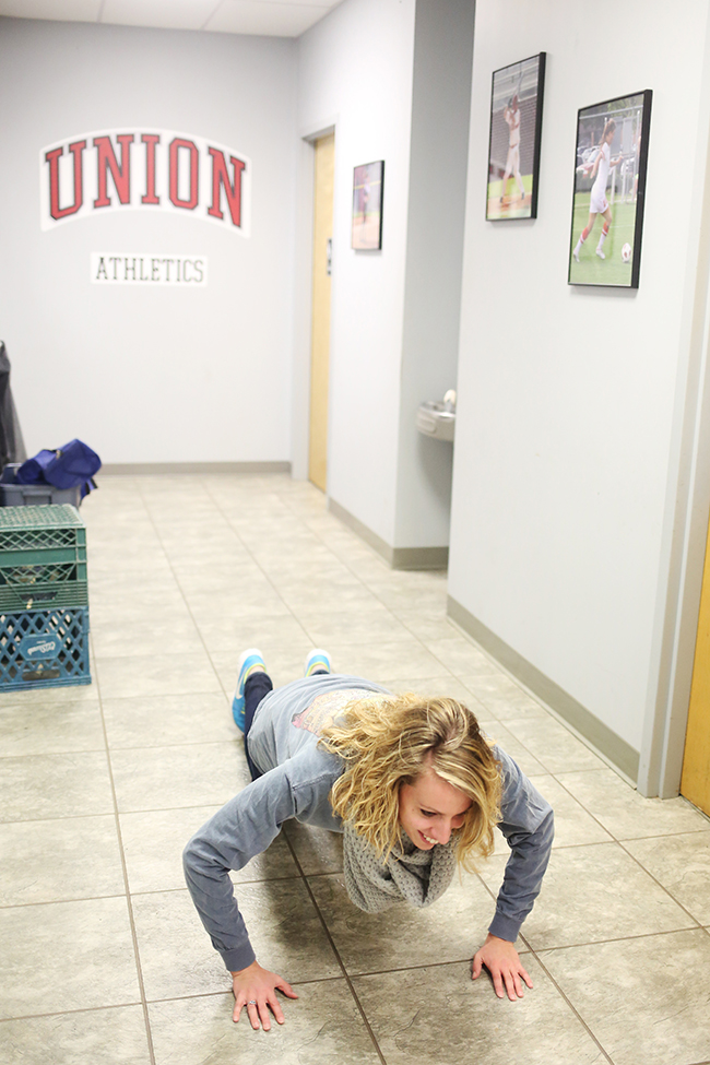 A student completes a physical challenge for the Amazing Race on campus