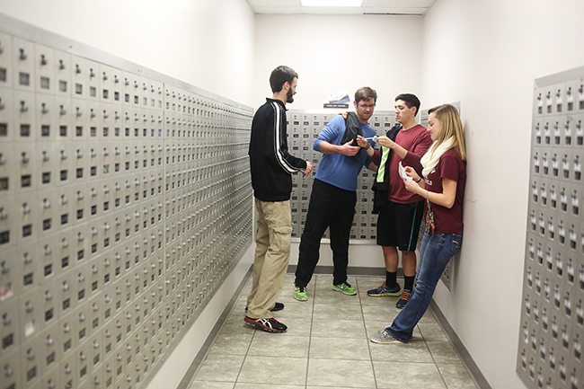 A team tries to solve a riddle in the Amazing Race game on campus