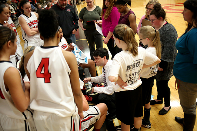Mark Campbell and players during a timeout