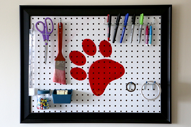 Pegboard in a picture frame, perfect for dorm room storage.
