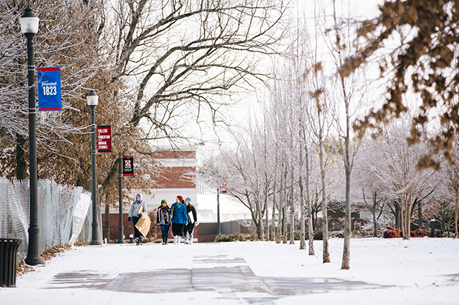 Students make their way across campus with makeshift sleds