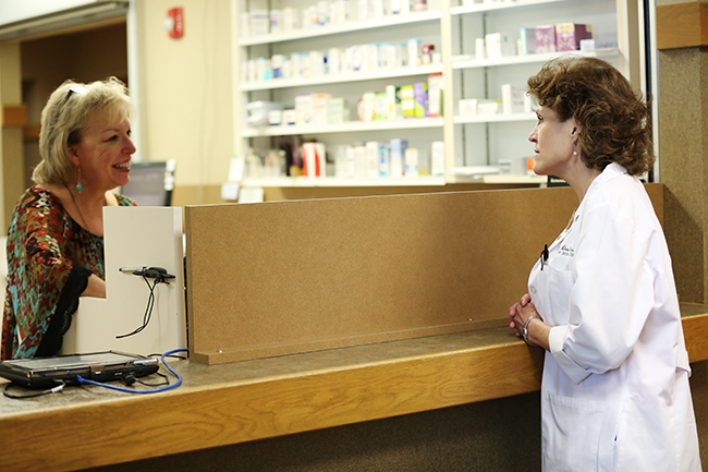 Lisa Rogers talking to the pharmacist at the Jackson Clinic
