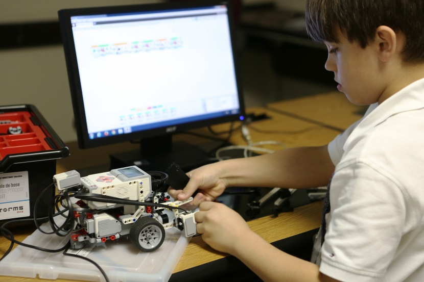 Camper working on his robot