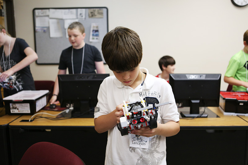 A camper working on his robot