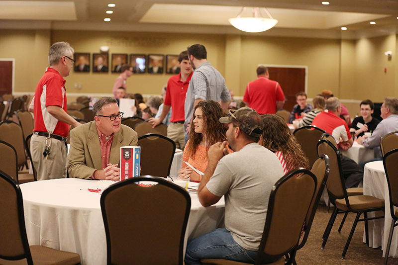 Prospective students mingle with faculty and staff during a breakfast