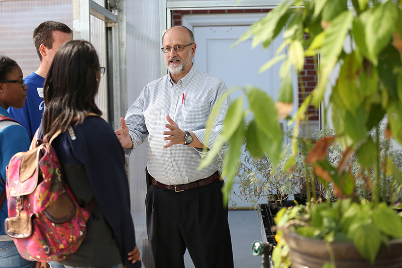 Wayne Wofford gives a tour of the biology greenhouse