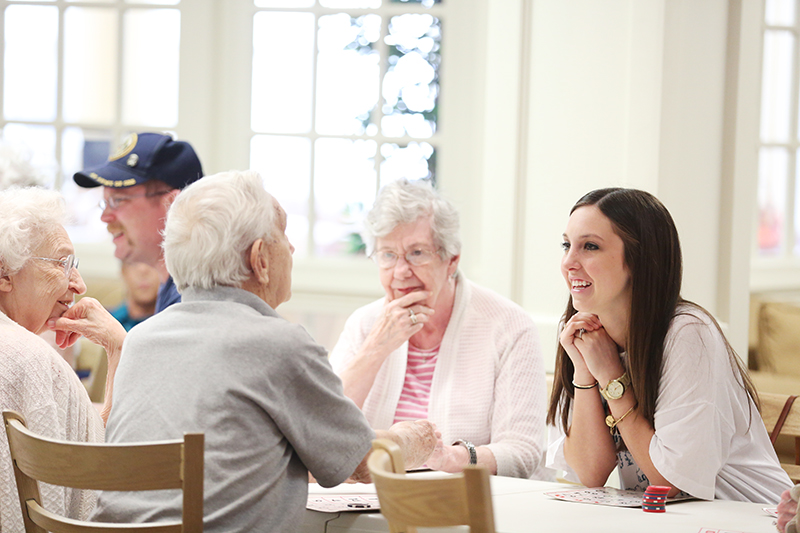 Abby Cox, a member of Chi Omega, gets to know residents of Recency Retirement Village during a game of bingo.