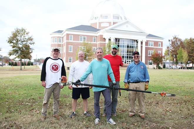 Members of the executive council pose together after trimming trees along the Great Lawn