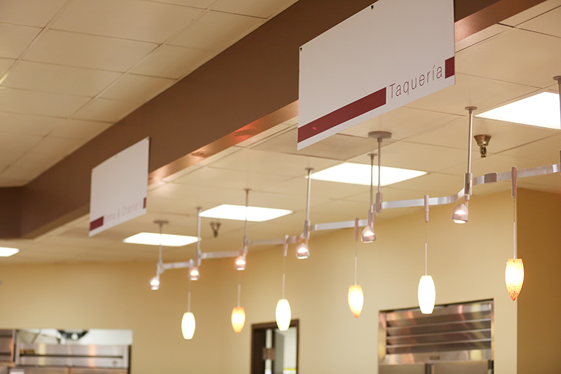 Signs show where lines are location in the cafeteria