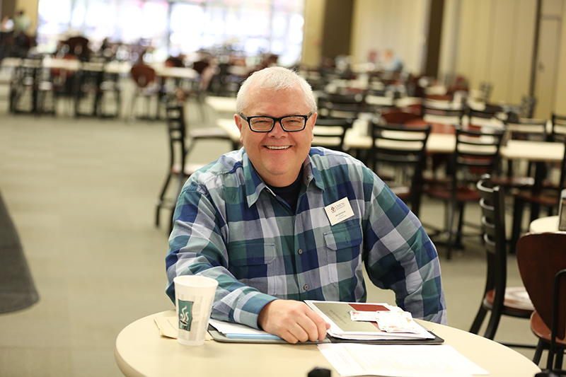 Jim Erickson, Food Service Director and Chef Manager, smiles in the Brewer Dining Hall